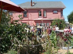 Visitors peruse the garden. Novella lives next door on the second floor.