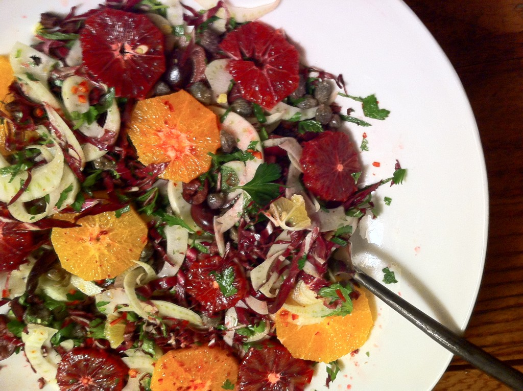 Winter salad with supremes of blood oranges, radicchio and capers.
